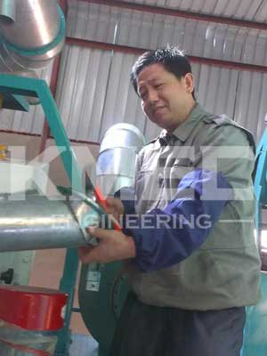 technical experts debugging maize flour milling machine